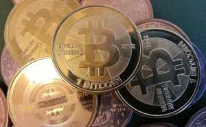 many-bitcoin-coins-300x185